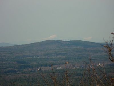 From Mount Agamenticus, a small mountain in southern Maine, it is possible to get a wide panoramic sight of the landscape. On one side the view opens to the Atlantic Ocean, with coastal towns and secondary forests dominated by White Pine. In the other direction, on a clear day, one can see the caps of the White Mountains, where snow remains well into late spring.