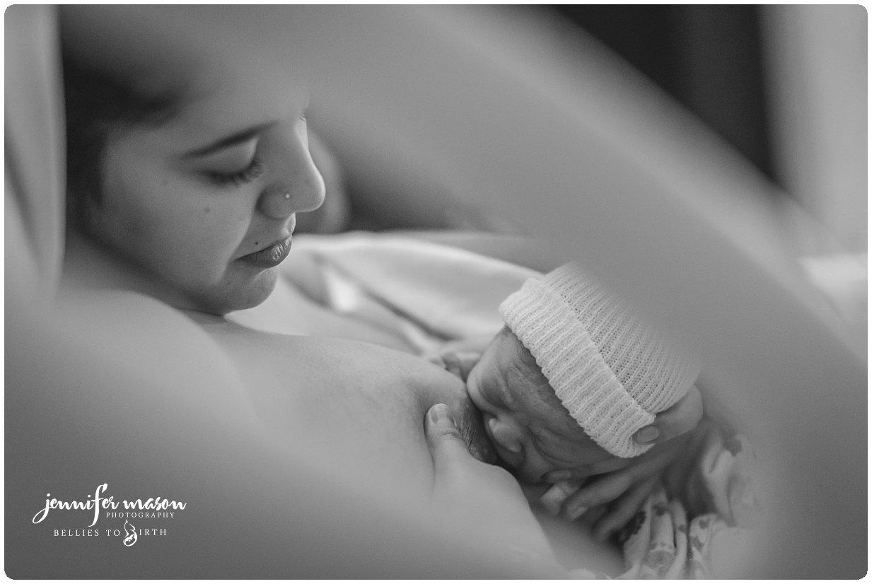 Thornton Colorado birth photographer, birth photography, crowning birth, hospital birth, mountain midwifery center transfer, north suburban hospital birth, epidural and hospital birth photography, Thornton birth photography