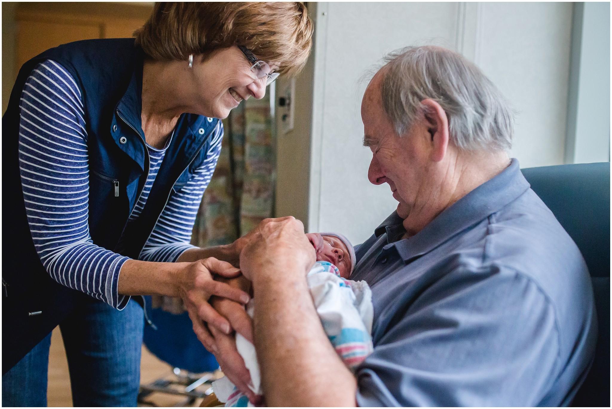Colorado grandpa holding grandson