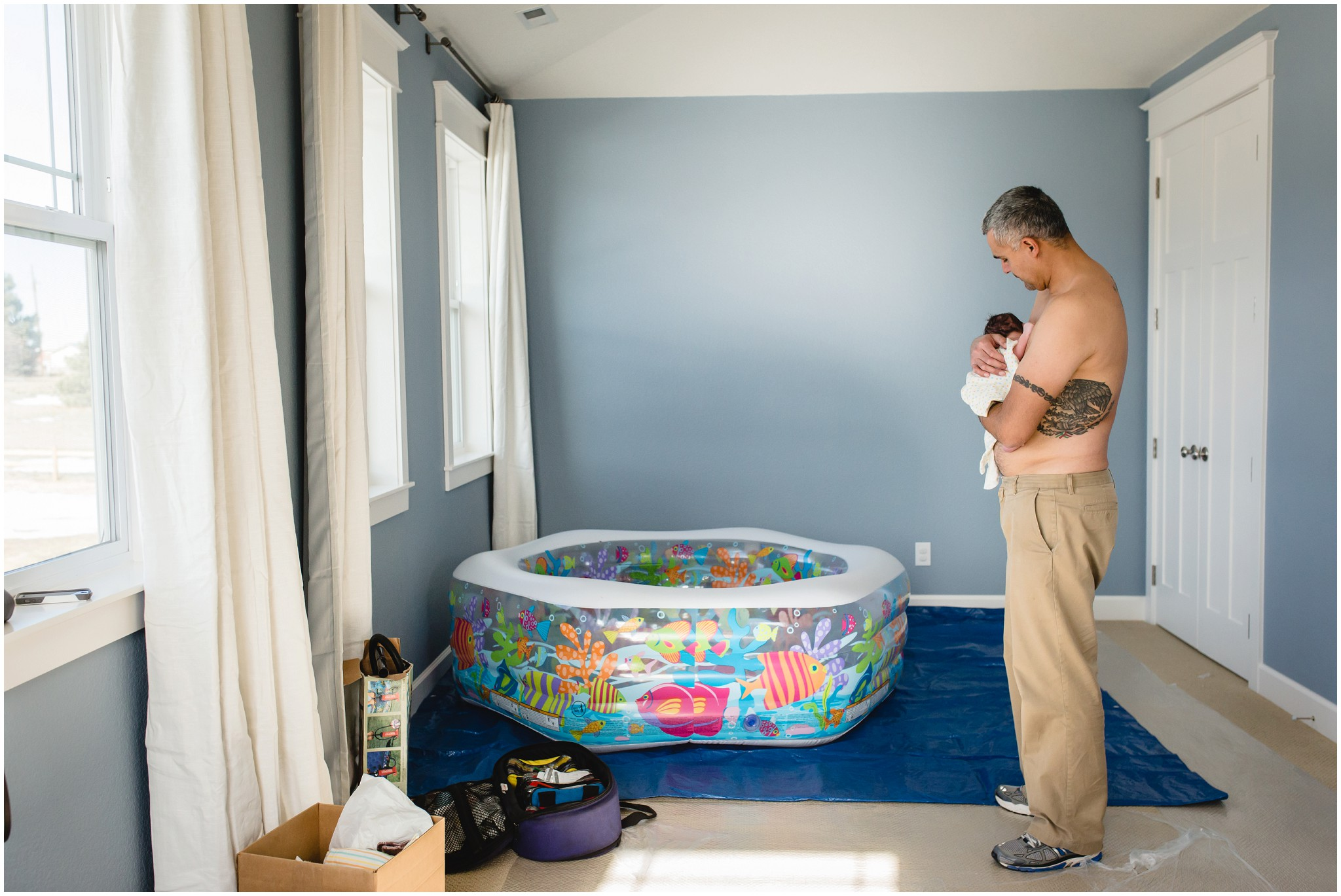 Home Birth Photographer in Parker captures dad holding baby