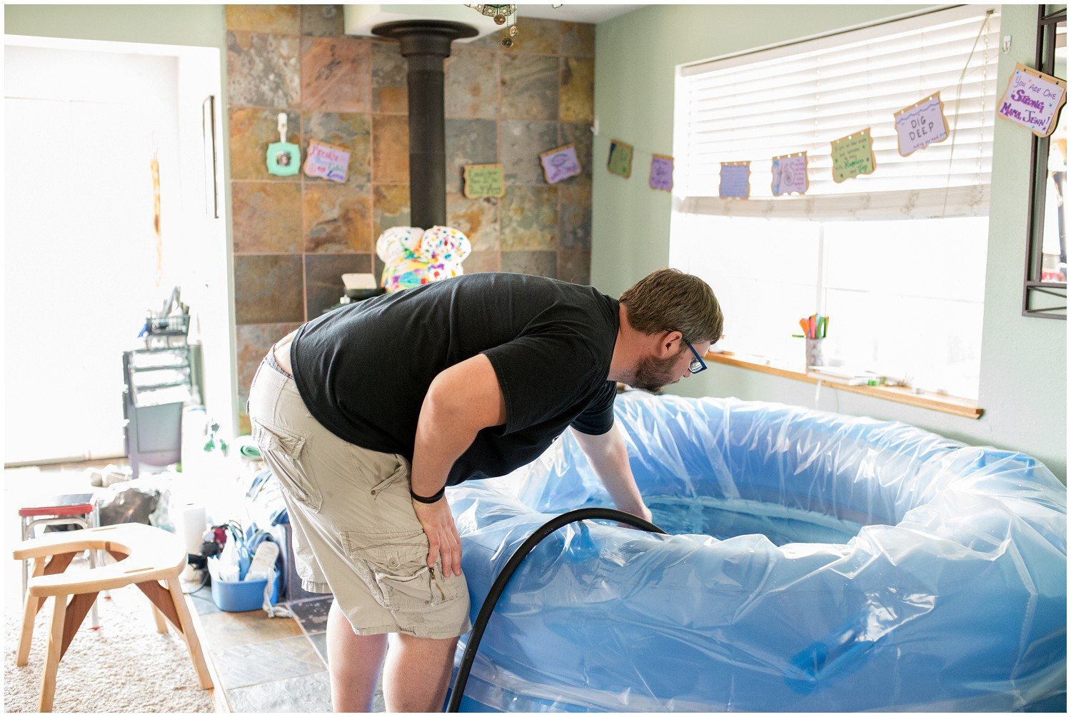 Home birth tub gets filled as photographer documents her journey in Denver