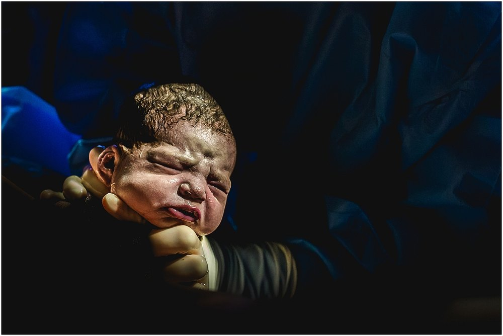 Birth photography captures first breathe