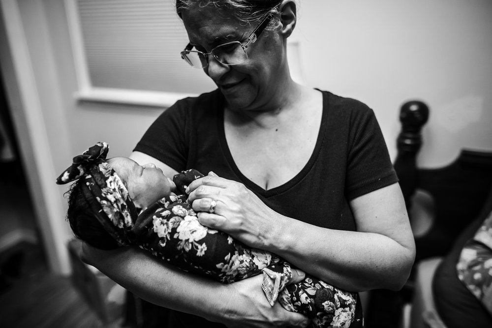 grandma-holds-baby-for-first-time