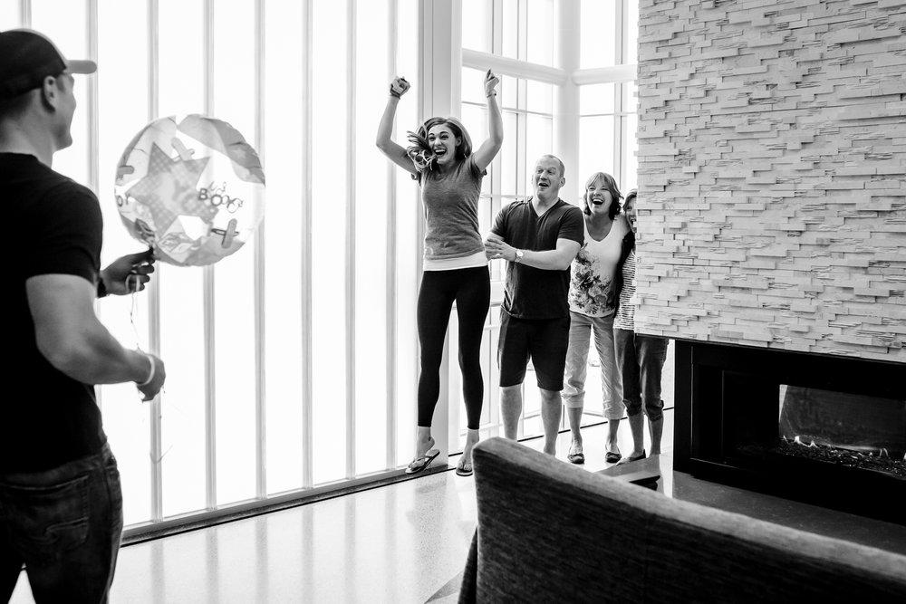 Excited-family-jumps-for-joy-hospital-birth-ann-arbor