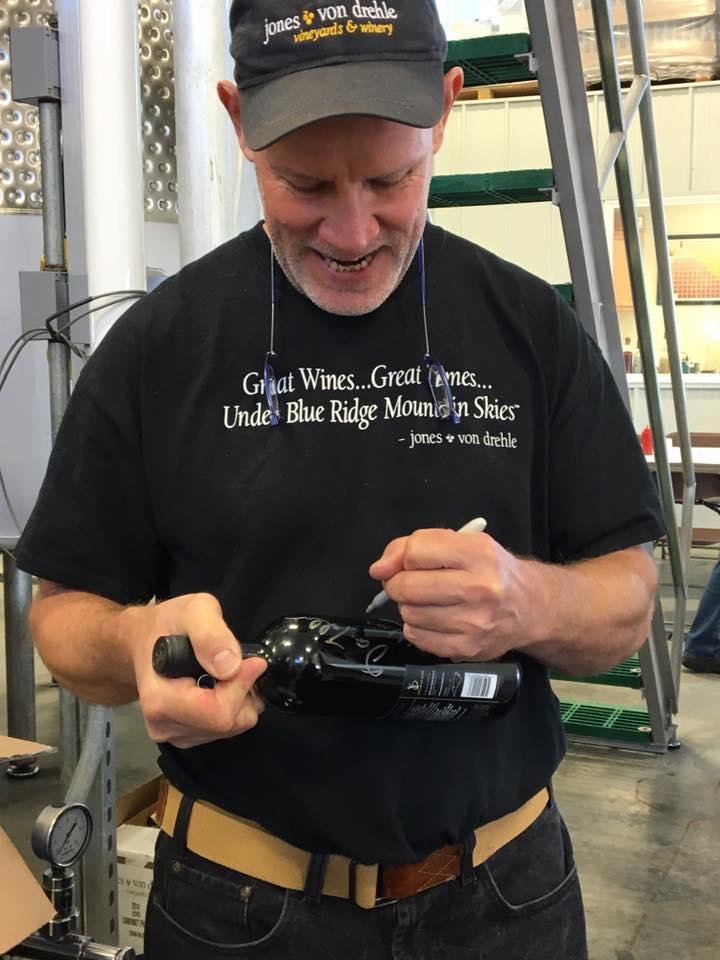 ASK A WINEMAKER TO SIGN A BOTTLE OF WINE - Jones von Drehle's winemaker Dan Tallman signs a bottle.
