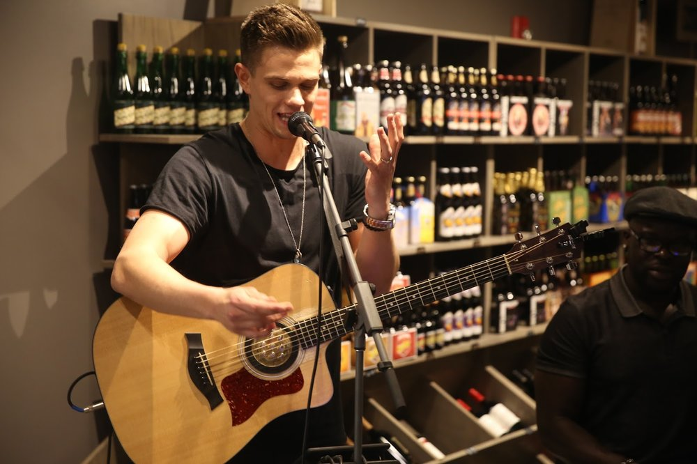 Nick Hagelin, who performed on NBC's The Voice, performed for the grand opening at PourWorks.