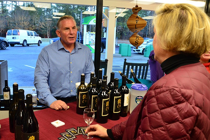 Steve Reynolds pours his wine during a tasting at Taylor's Wine Shop in Raleigh