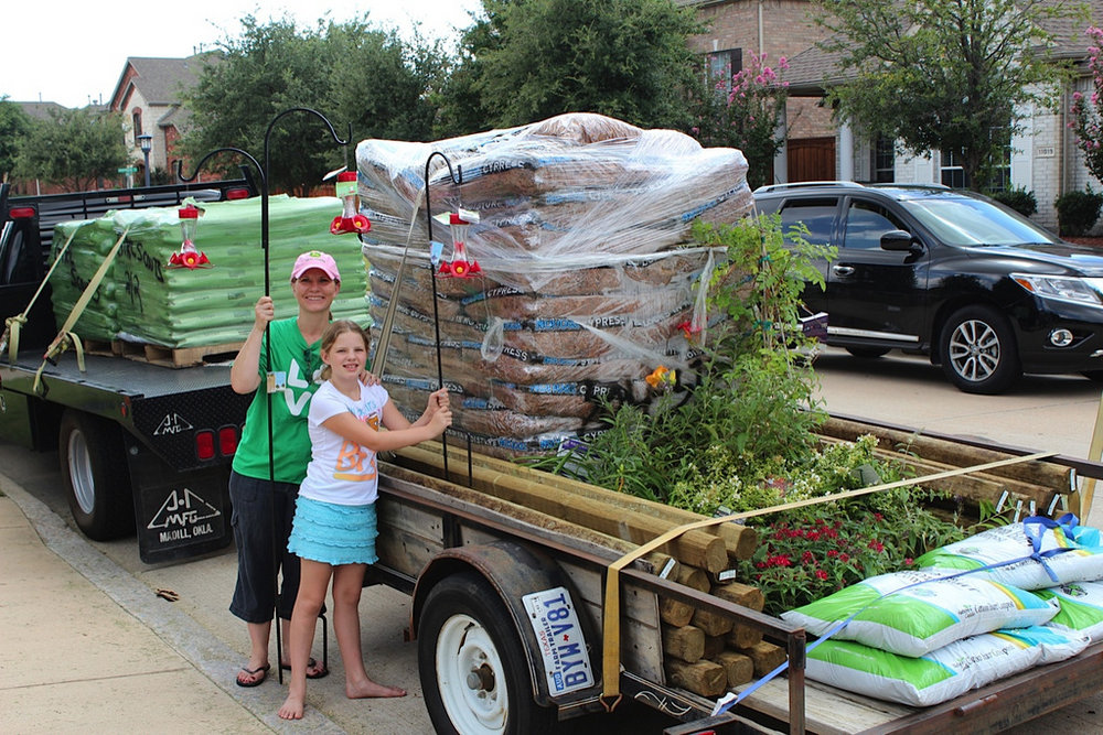 Girl Scouts get donations for the Community Service Project, Hummingbird Garden.