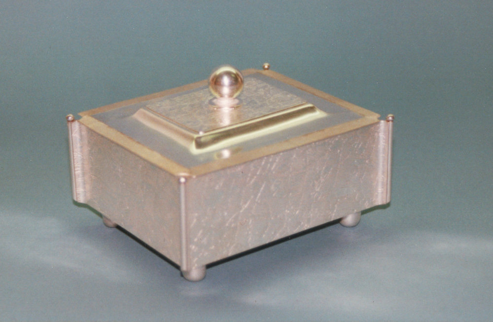Box with a hinged lid