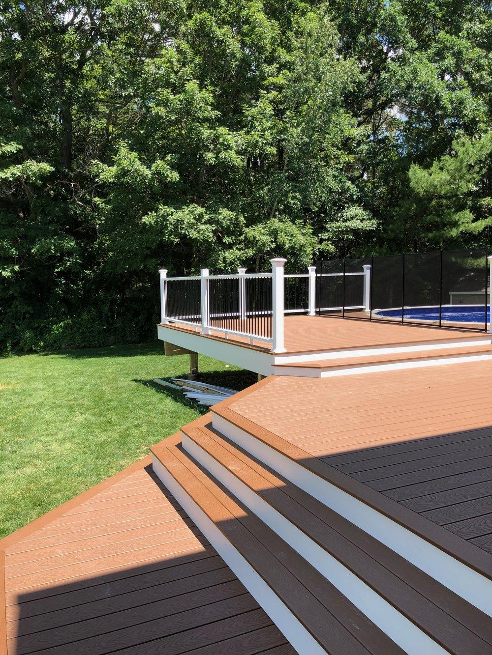 Custom tiered composite pool deck.