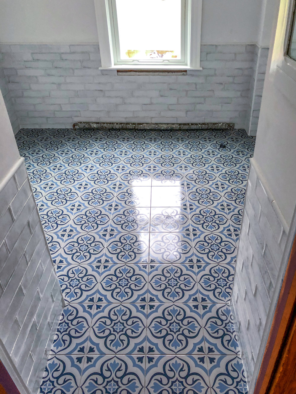 Hand-made ceramic tile with a glass subway wall tile.