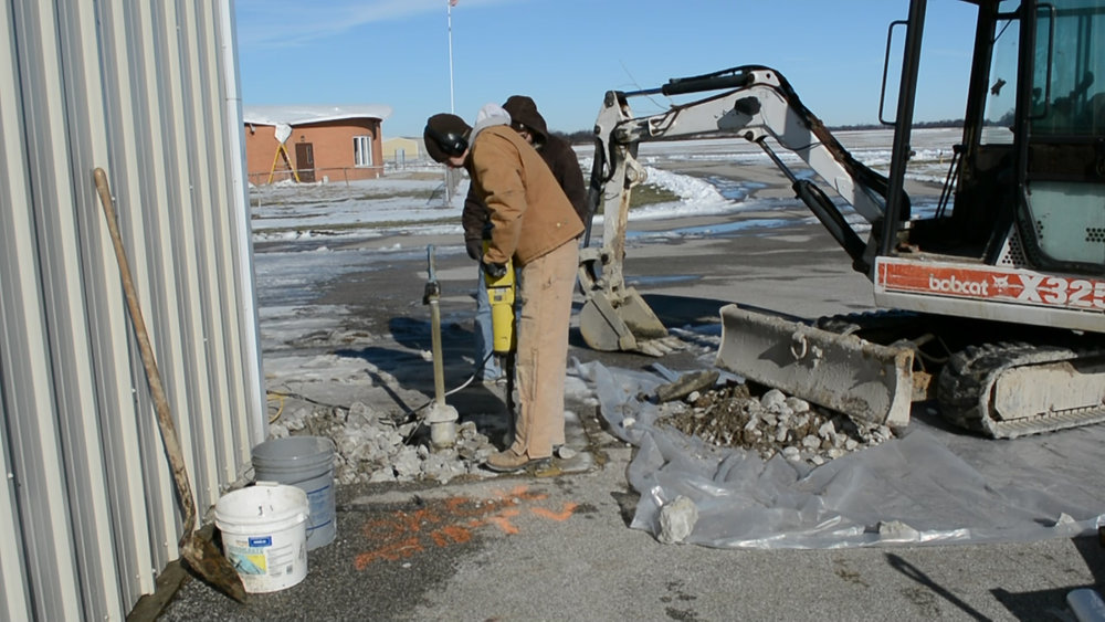 yard hydrant concrete jackhammer.jpg