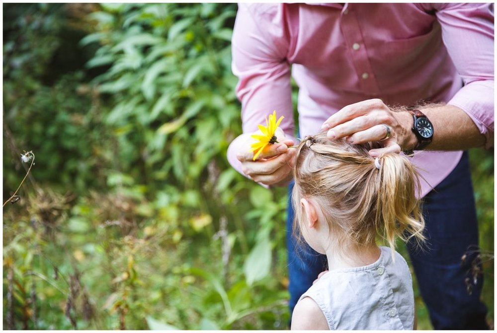Daddy daughter bonding, with the wild flowers.