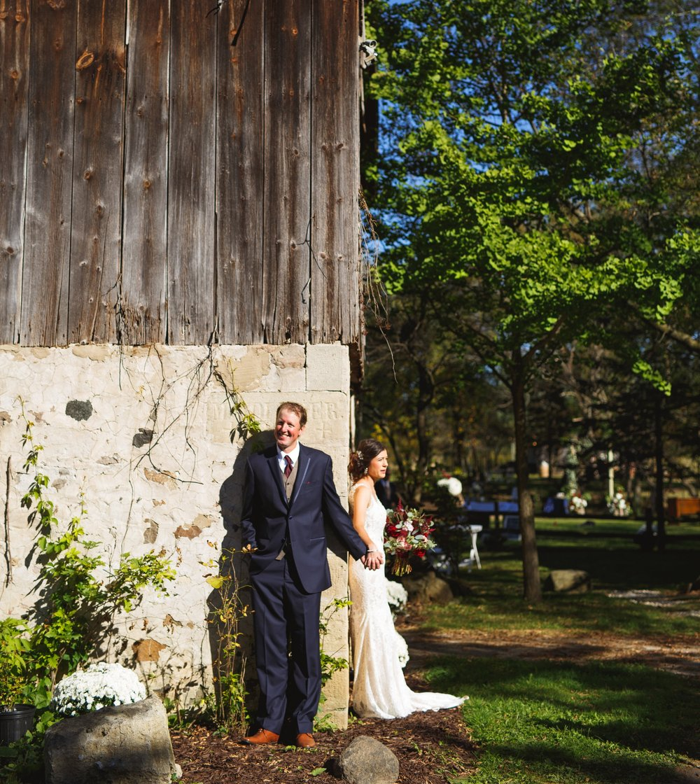 Katie + Ryan chose this spot on their farm, the cornerstone of the property, to hold hands and have a quick chat to ease nerves before their ceremony.