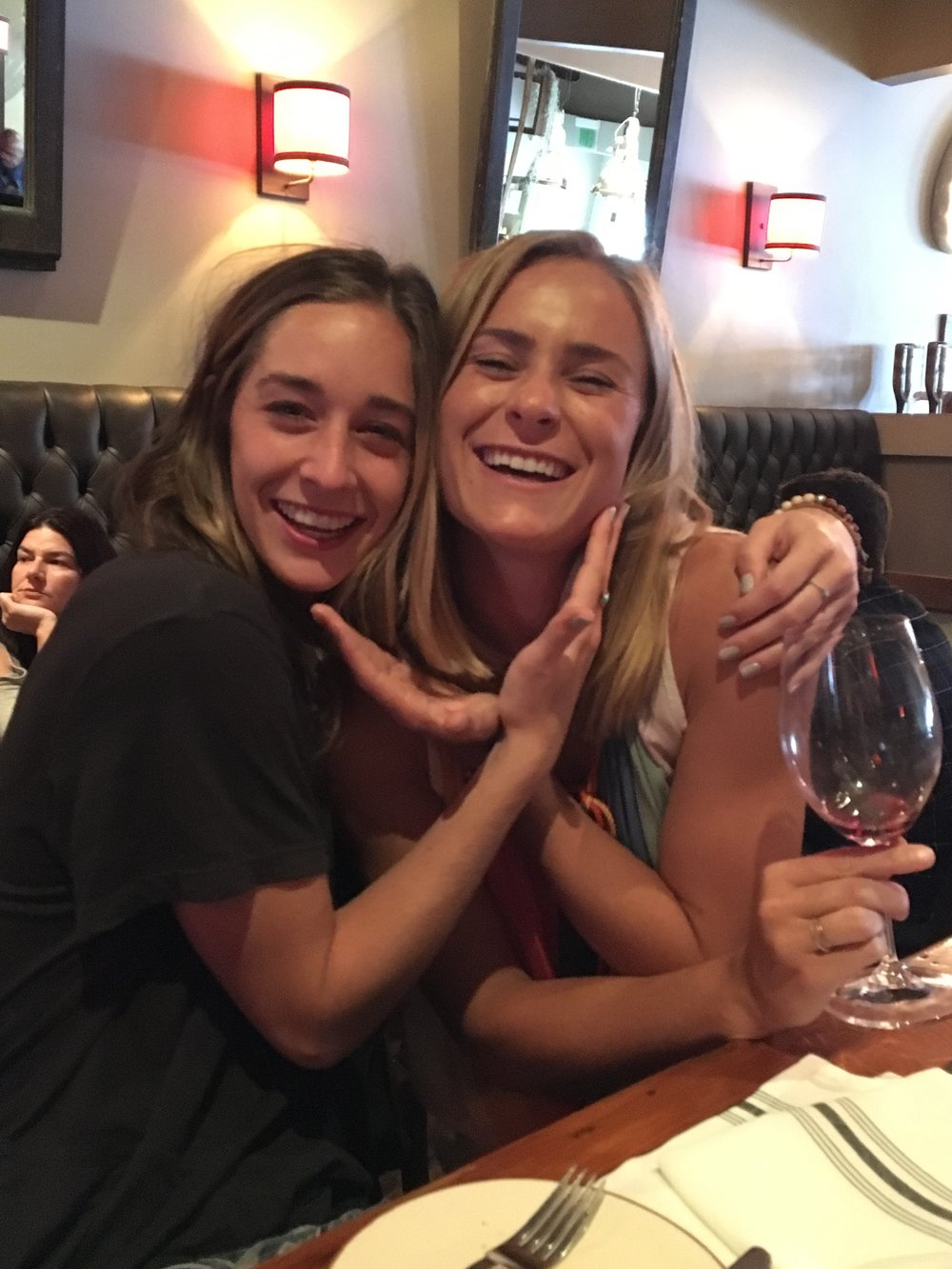 My cousin and I at the wine bar. SO oblivious to what was about to happen!