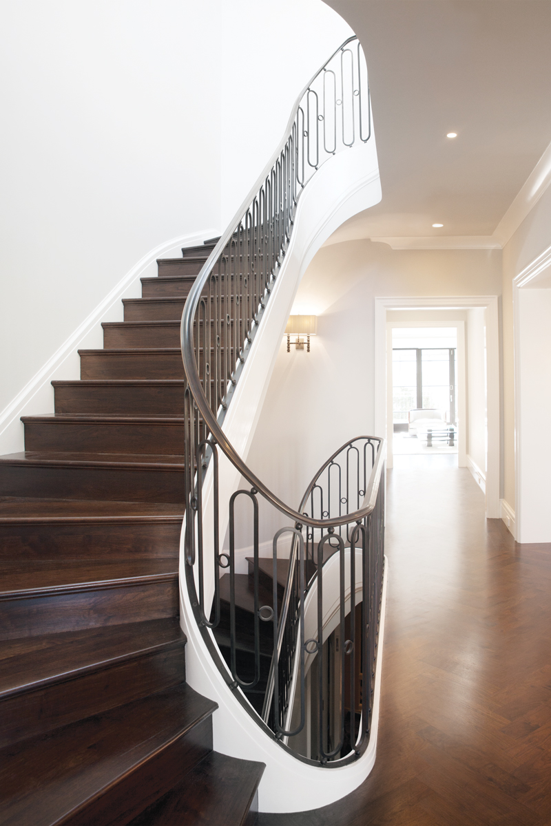 Marina spiral - Three-story racetrack spiral stair rail. Patinated bronze cap rail, blackened cold rolled steel, custom pickets. Private residence, Marina District, San Francisco