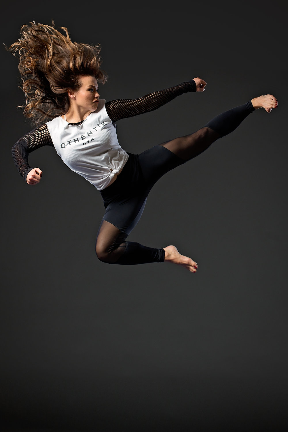 """Ka'imi Kuoha - Ka'imi is a SAG / AFTRA / EQUITY actor, working professionally since she was 2 years old. She was a competitive gymnast for 5 years and is also a dancer and jazz singer. She is a 7th-degree black belt in Kempo with 30 years of experience. She also trained in Kung-Fu (13 years), Aikido (20 years) and Arnis stick fighting. She has held the world record for female ice breaking since 2010 and she was named one of the """"Top 10 Female Martial Artists in the World"""" in 2013. Continue From 1993-1999, she was rated #1 in 3 regions. She has been featured on the cover of martial arts magazines around the world.Ten years ago, when her daughter was an infant, Othentik Gym CEO and founder Ka'imi Kuoha needed a way to get back into her training regimen. The mother and baby classes she found at the time were limited, and much of the inspiration for Othentik Gym grew from that need for a space where mothers could work out with their babies, rather than just placing them in day care. The Othentik Mini & Me Bootcamp program allows moms to meet their own fitness needs while spending quality time with their babies. To make things even easier, there are classes for older siblings at the same time, so the whole family can enjoy the benefits of an active life. Throughout her years of training as a martial artist, Ka'imi found that she needed to learn various styles of martial arts, and even different disciplines like dance and yoga, to become a balanced athlete. She spent a lot of time traveling from studio to studio for those classes and even to other states and countries.At OTHENTIK Gym, Ka'imi and her partners have created a place where students can access a well-rounded training curriculum, with world-class teachers from many disciplines, all under one roof. Her ultimate goal is to is to be an example for her daughter; to empower her, and all women, to create a healthy world for themselves and their families."""