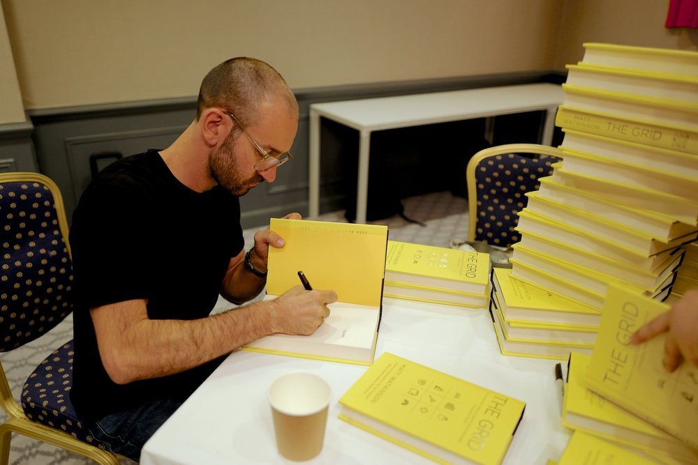 Author Matt Watkinson signing copies of The Grid book.jpg
