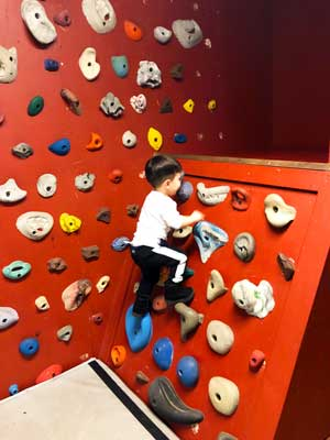 The rock climbing wall is a place where kids can challenge themselves and burn off pent-up energy.
