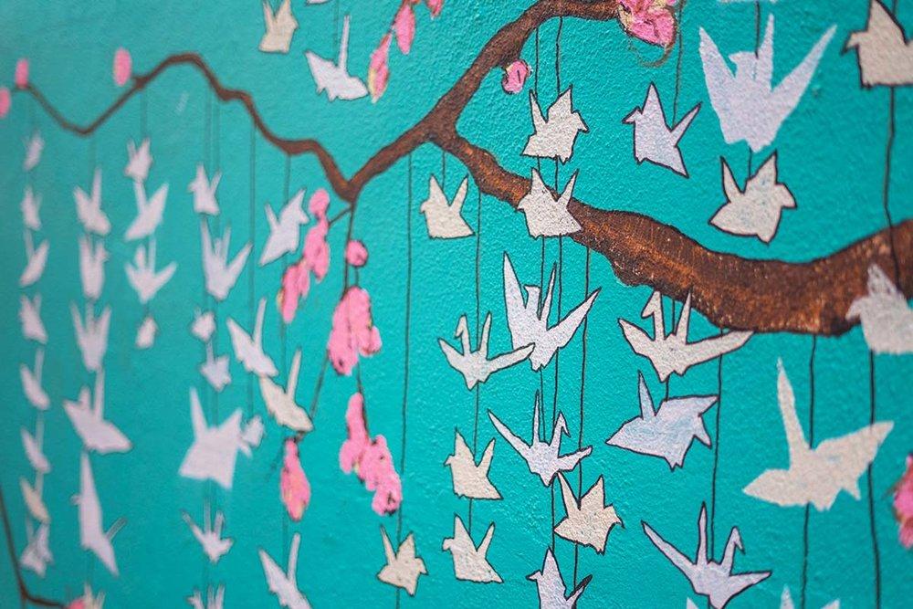 The paper cranes on the side of Graze on Spokane Street