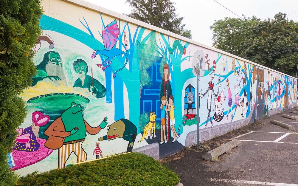 Along one wall of the Walla Walla Public Library is a mural featuring fictional children's book characters.