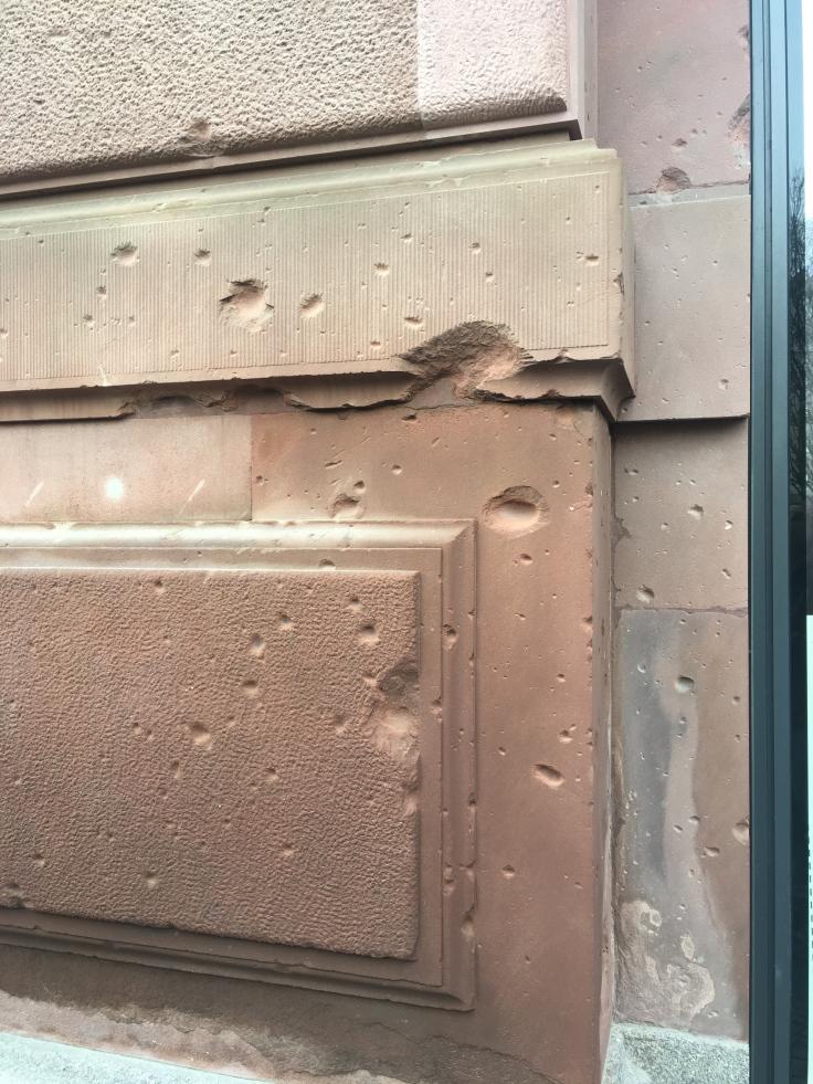 bullet-holes-in-east-berlin-building.jpg