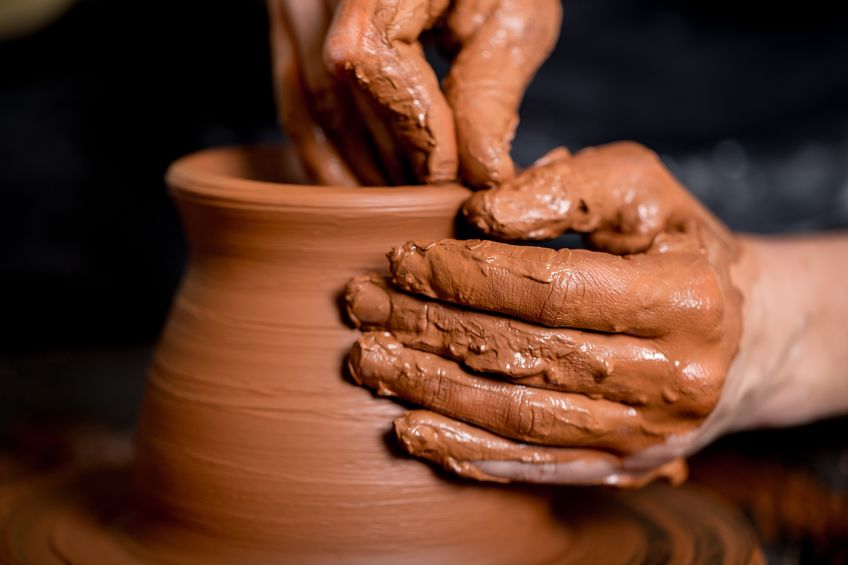 hands throwing pottery.jpg