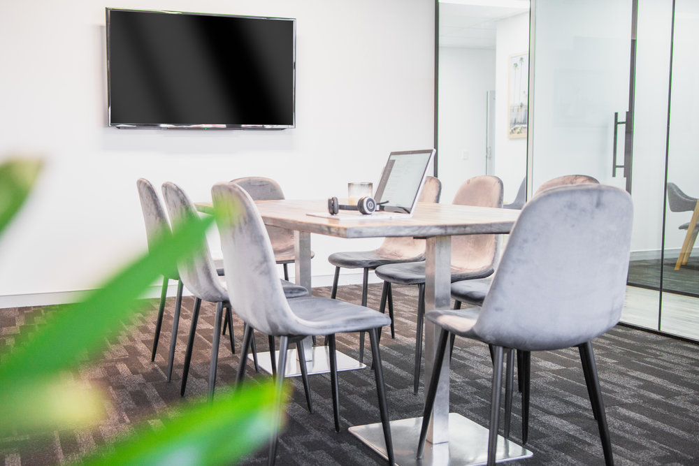 Formal Boardroom - $50/hourLarge table with 8 chairsTV with HDMI or chrome-cast