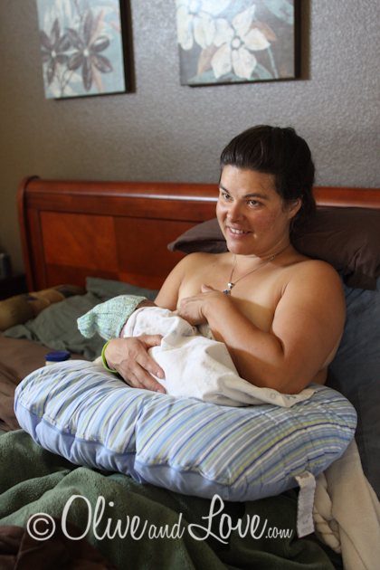 nursing newborn with boppie, home birth, water birth