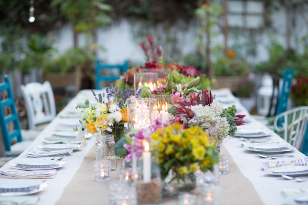 long table set up in the backyard for a garden party