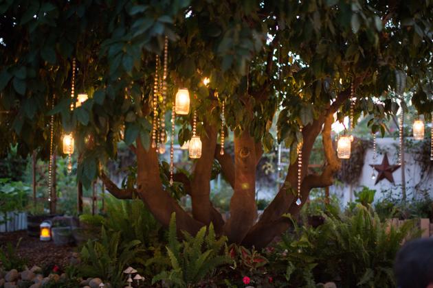 twinkle lights in mason jars under tree