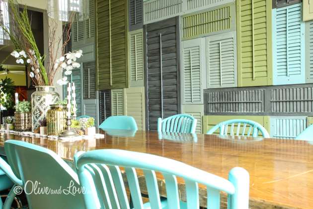 """different chairs same color"" Before and after ratan and wicker chairs painted blue with a shutter wall and eames chairs"