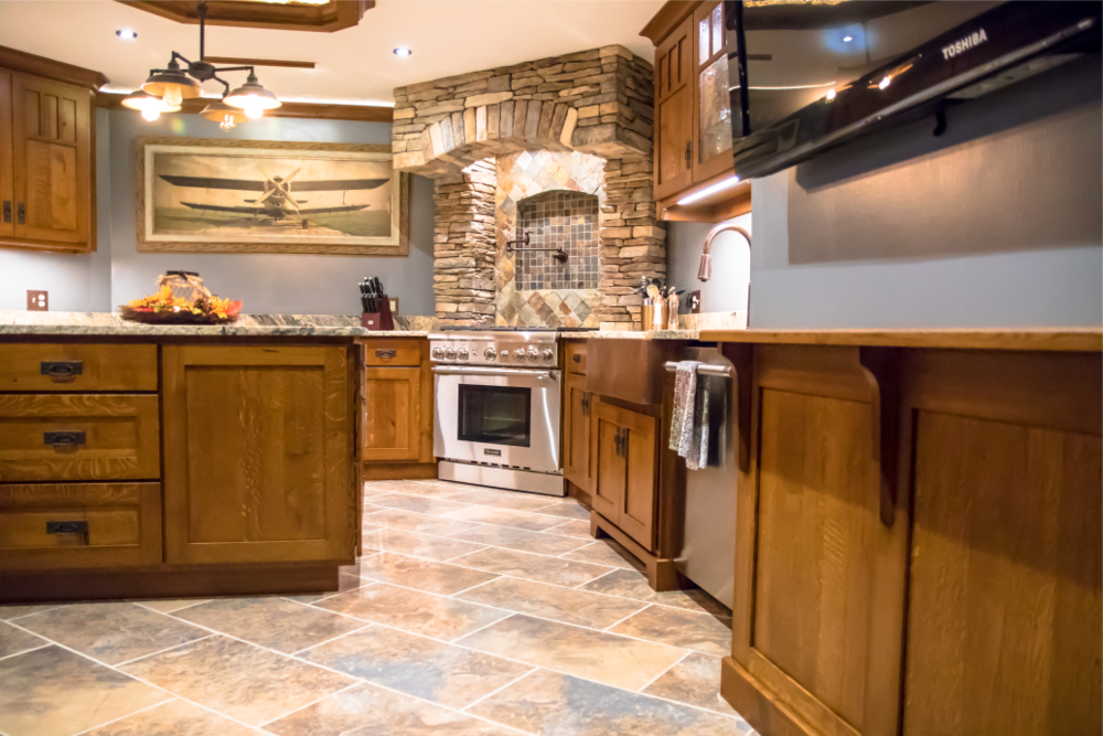 Room to Spread Your Wings - Family room entertaining just got serious. This couple loves to entertain and wanted a kitchen large enough for everyone to gather. The space adjoins a home bar, billiards room, and a large patio.
