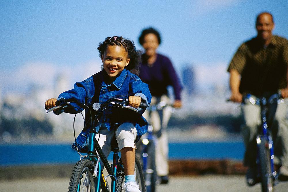 kid and parents biking.jpg