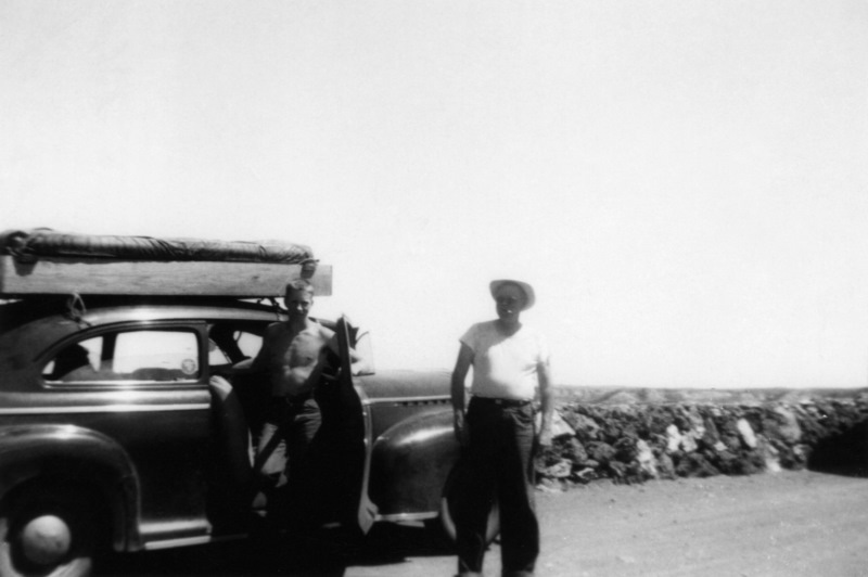 With my father on a trip to Yellowstone in 1949, with a tent strapped on top of the car.