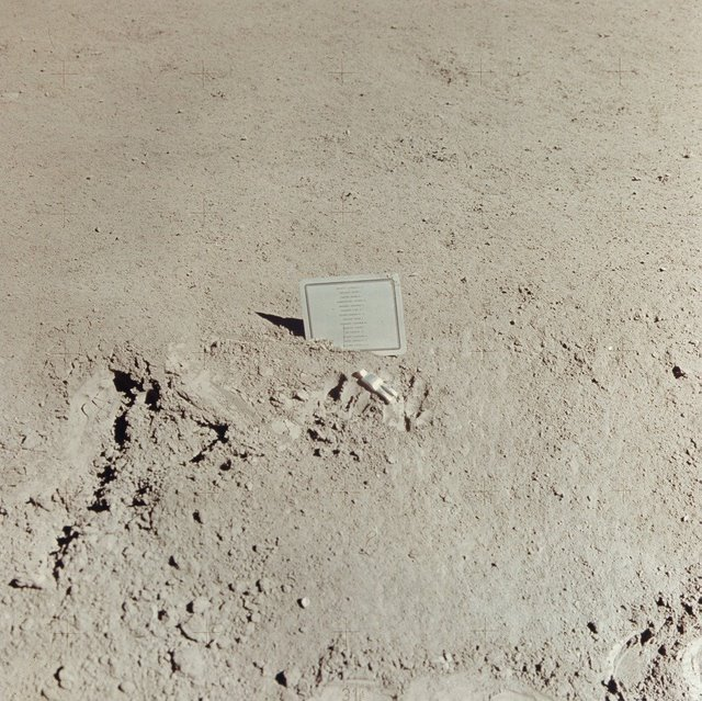 The Fallen Astronaut sculpture left on the surface of the moon, with a list of known deceased astronauts and cosmonauts.