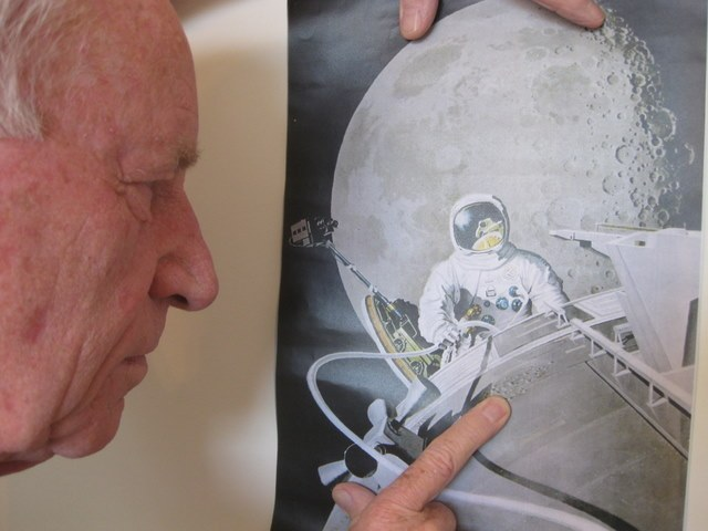 Looking at a copy of the painting Pierre Mion did of my view during my spacewalk.