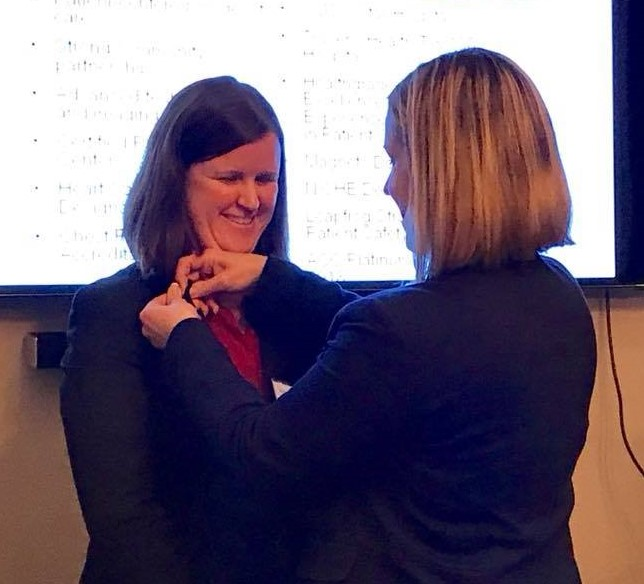 Newest member - Sue Harmon, right, pins new Satellite member Alice Jacobs