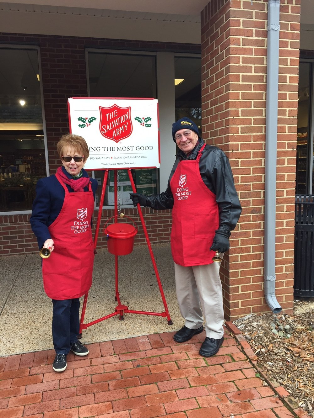 salvation army bell ringing - Neva & Ron Lynde ringing their bells for the Salvation Army.