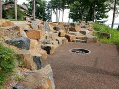 Natural boulder retaining wall with blasted rocks