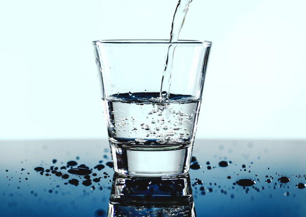 Glass of water rawpixel-687066-unsplash.jpg
