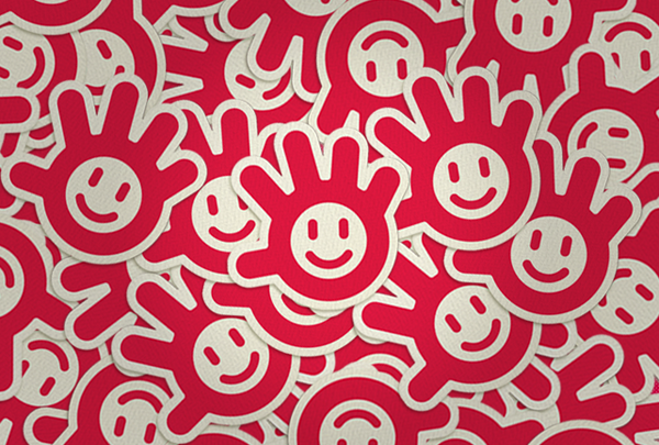 """Redkroft, a design agency in Poland, donated beautiful brand identity and logo designs for Project Smile. The """"helping hand"""" smile logo concept as described by Redkroft, """"behind a simple muscle contraction lies a deeper meaning, a desire to help one another, a desire to lend a helping hand."""" """"We combined these two ideas into one - a helping hand, carrying and passing the smile on."""""""