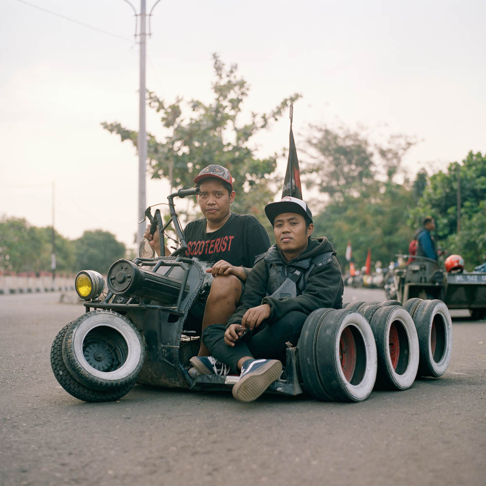 Tiko and Arif, two scooterist from Kediri, East Java, as seen in Java Extremist 2018 in Semarang. They traveled for three days to attend the annual gathering.