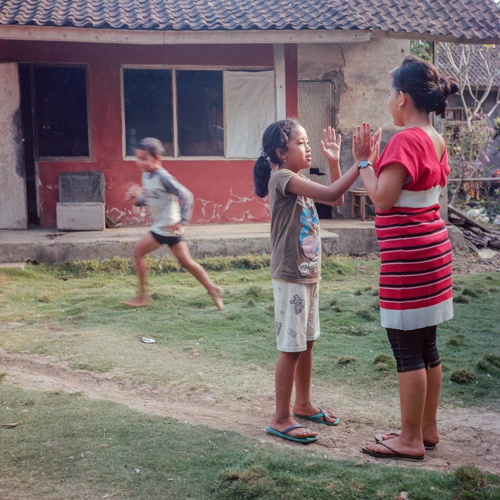 Kids play in the yard at Tunjuk Village, Bali, Indonesia.