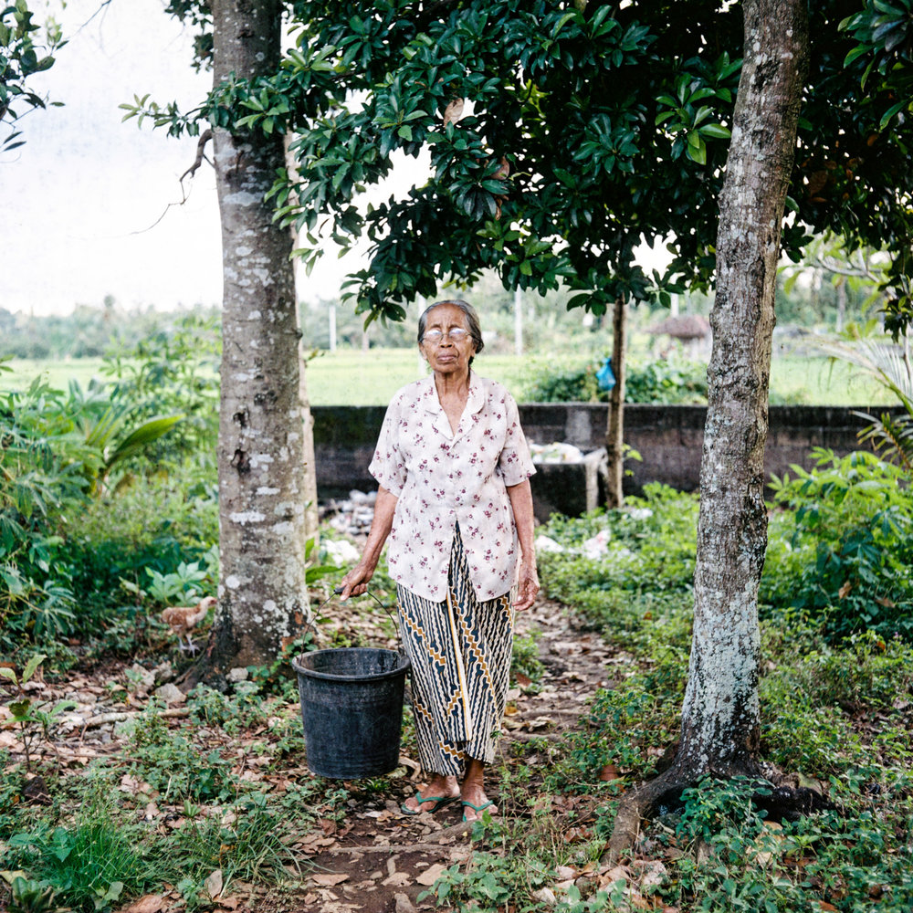 Dadong Topa poses for a portrait at Tunjuk Village, Bali, Indonesia.