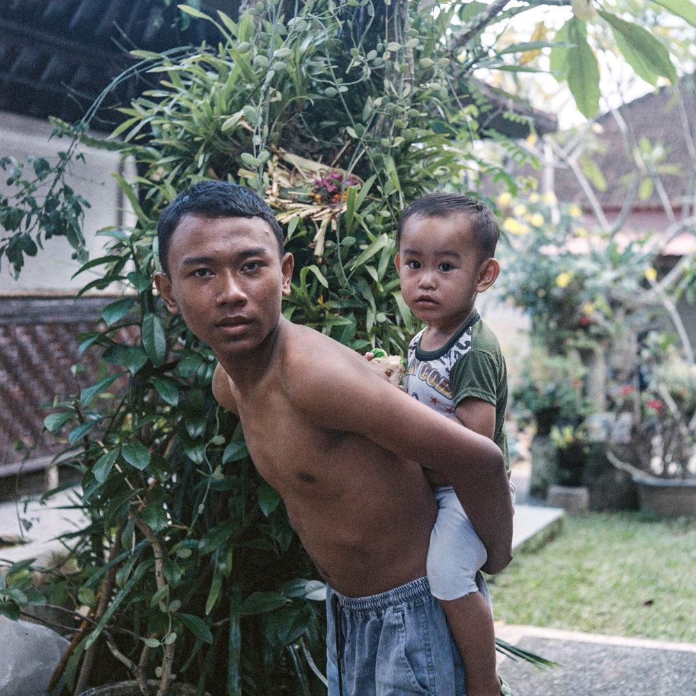 kadek and koming poses for a portrait at Tunjuk Village, Bali, Indonesia.