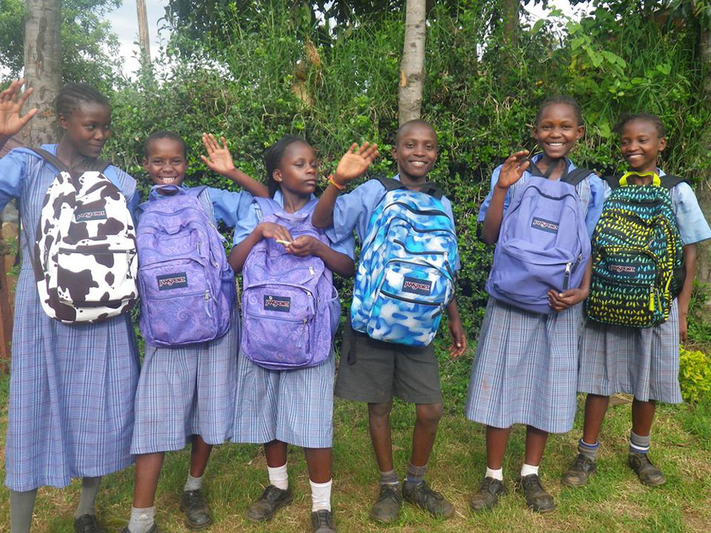 A few of the Arrive children showing off their new backpacks, donated by Trekking for Kids and Jansport.