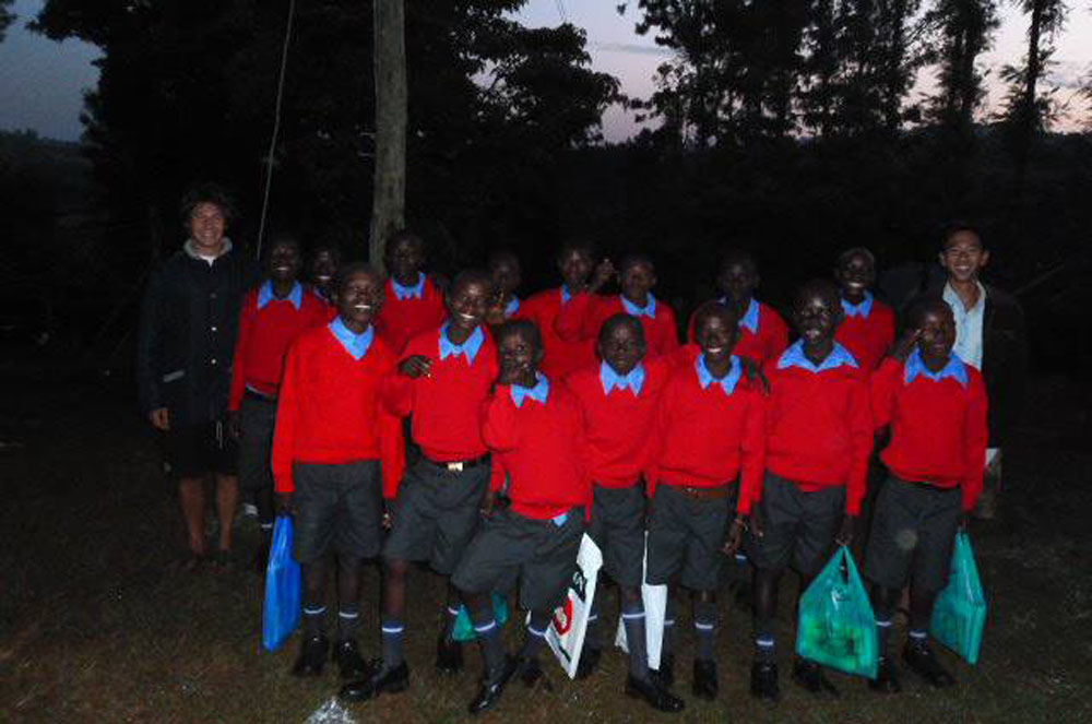 Here are all 15 boys beginning their trek to school as the sun rises. I am on the far left and Kevin Vu, a volunteer, is on the far right.