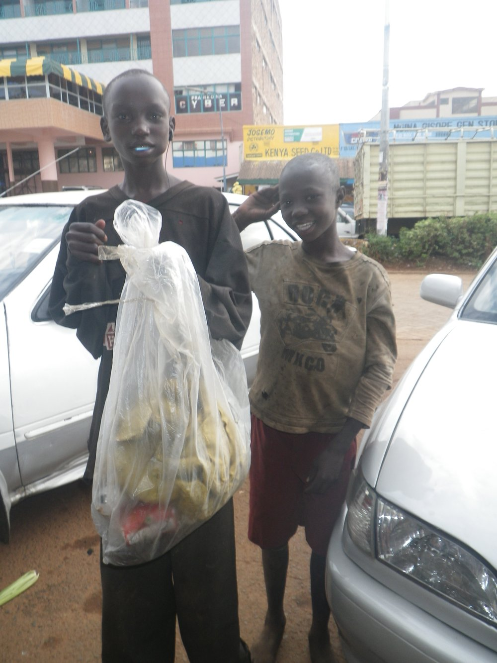 Two of the many street boys in Kisii. Daniel Mogaka (left) and Brian (right). Daniel had lived in Kisii for 6 years, and Brian is only 9 years old.