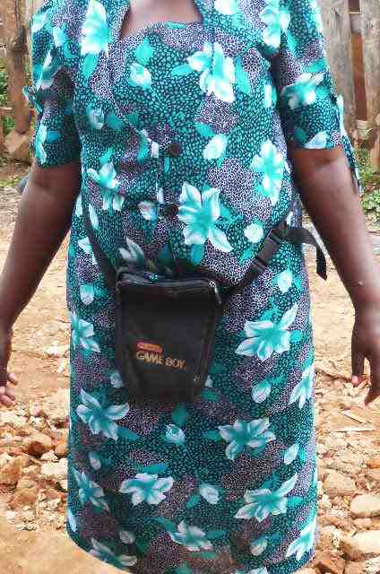 The old GameBoy case being used as a purse.